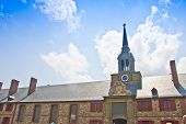 stock photo of acadian  - Military barracks and clock tower at the reconstructed Fortress of Louisbourg  - JPG