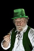 Irish Leprechaun Looks Amazed At Gold Coin