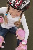 Lovely Portrait Of Smiling Cute Blond Caucasian Girl With Rollerblades