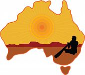 stock photo of didgeridoo  - A stylized map of Australia with a silhouette of an aboriginal playing a didgeridoo - JPG