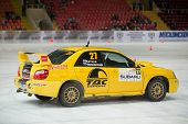 MOSCOW - APR 21: Katkov and Tchaikovsky in racing car on ice in sports complex Krylatsky, on Rally M