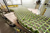 MOSCOW - MAY 16: Many open green cans move on conveyor in Ochakovo factory, on May 16, 2012 in Mosco