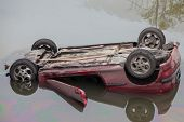 MOSCOW - OCT 9: The red Peugeot 206 fell into the river Yauza and capsized on October 9, 2011 in Mos