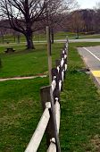 stock photo of split rail fence  - A split rail wood fence in a town park - JPG