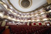 MOSCOW - APRIL 23: Balconies and luster in auditorium in Vakhtangov Theatre on April 23, 2012 in Moscow, Russia. Auditorium of Large stage of theater accommodates 1055 people.