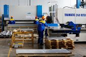 LOBNYA - JUN 7: Workers in extrusion workshop at plant of Group of companies Metal Profile, June 7,