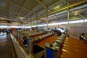 LOBNYA - JUN 7: Line for forming shaped metal sheets in manufacturing workshop at plant of Group of companies Metal Profile, June 7, 2012, Lobnya, Russia.