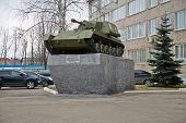 MOSCOW - APR 18: Armored artillery weapon SU-76 on pedestal near to building of plant management of