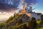 stock photo of mansion  - Ruin of castle Cachtice at sunset  - JPG