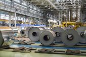 Rolls of aluminum lie in production shop of plant in special places.