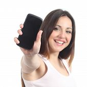 stock photo of generic  - Happy woman showing a black mobile phone screen isolated on a white background - JPG