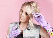 Blond Woman Wearing Latex Gloves