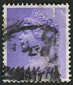 UK-CIRCA 1973:A stamp printed in UK shows image of Elizabeth II is the constitutional monarch of 16 sovereign states known as the Commonwealth realms, in lilac, circa 1973.