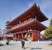 TOKYO - FEBRUARY 7: Visitors pass the Hozomon gate at Senso-ji Temple February 7, 2013 in Tokyo, JP.