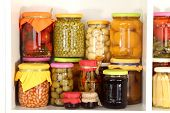 pic of pickled vegetables  - Different conservations on white shelf - JPG