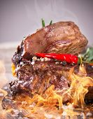 Delicious beef steaks with fire flames