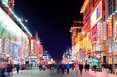 BEIJING, CHINA - APR 1: Wangfujing commercial street at night on April 1, 2013 in Beijing. It is one