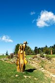 SOLAN, MORAVIAN BESKYDY, CZECH REPUBLIC CIRCA  SEPTEMBER 2011 - Wooden sculptures in the meadow in f