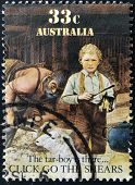 A stamp printed in Australia shows sheepshearing Tar-boy is there