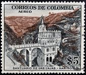 A stamp printed in Colombia shows Santuario de las Lajas Narino