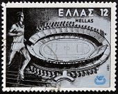 stamp printed in Greece shows Runner Olympic Stadium Kalogreza