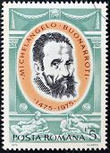 A stamp printed in Romania shows Michelangelo Buonarroti by Jacopino del Conte