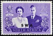 A stamp shows King George VI and wife commemorate British Royal family visit to RSA
