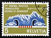A stamp printed in Switzerland shows a Road Tunnel Through Great St. Bernard