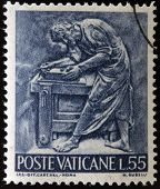 A stamp printed in Vatican shows Bas reliefs of arts and crafts carpenter