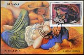 Stamp printed in Guyana shows still life with guitar and sleeping farmers by Picasso