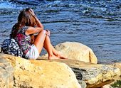 picture of depressed teen  - A girl that is in deep thought or a little depressed looking out into the water - JPG
