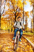 Boys Ride In Autumn Park