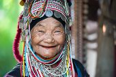 CHIANG RAI, THAILAND - DEC 4: Unidentified Akha tribe elderly woman with traditional clothes and sil