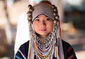 CHIANG RAI, THAILAND - DEC 4 : Akha girl with traditional clothes and silver jewelery in akha hitt t