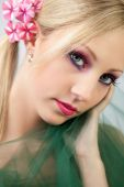 Pretty Blond Model With Flower In Hair And Dramatic Makeup