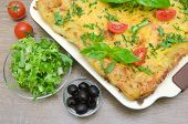 Lasagna, Tomatoes, Olives And Salad Friese