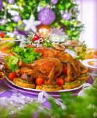 foto of centerpiece  - Closeup on tasty baked oven chicken on centerpiece of festive table in Christmas eve - JPG