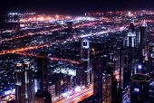 Dubai city at night, UAE, beautiful bird eye view on glowing downtown, panoramic cityscape, luxury A