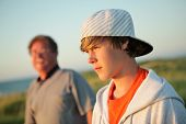 Serious teen with father