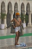 Aged Sikh Preparing For Ritual Ablution In The Temple