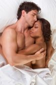 stock photo of late 20s  - nude heterosexual couple in bed peacefully sleeping in embracing each other in hug - JPG