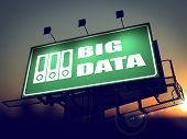 Big Data on Green Billboard at Sunrise.