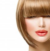 Fringe Hairstyle. Beauty Girl with short Hair.