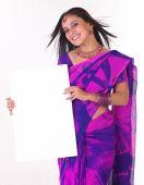 Asian girl holding white board