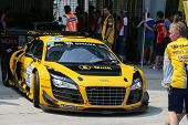 SEPANG, MALAYSIA - MAY 11, 2014: Driver Henk J. Kiks in an Audi R8 LNS car leaves for the tracks to