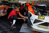 SEPANG, MALAYSIA - MAY 11, 2014: Unidentified team mechanics work on the cars for the Lamborghini Su