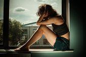 Sad And Upset Woman In Window