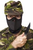 Male Self Defense Instructor With Camouflage Do A Self Defense Exercise With Knife, Isolated On Whit