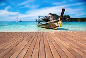 Wooden pier and Andaman sea - exotic holiday background