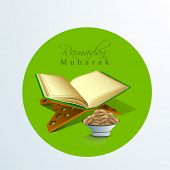Open islamic holy book Quran Shareef with fresh dates and stylish text Ramadan Mubarak .